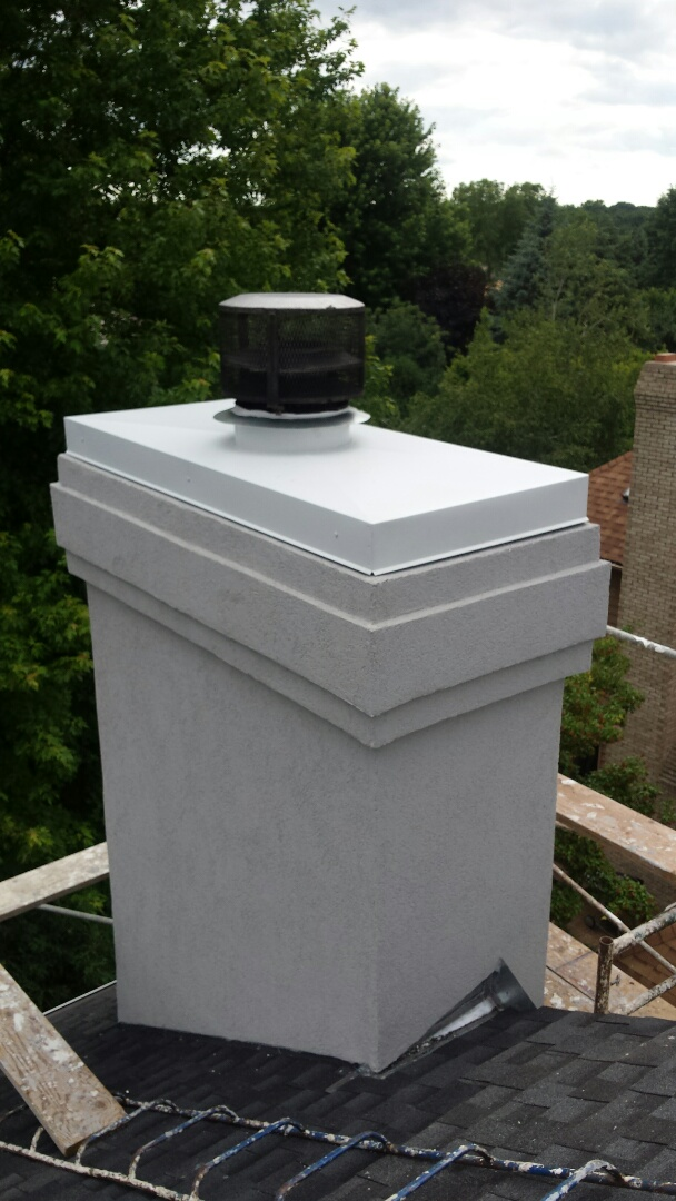 Saint Paul, MN - Fabricated and installed new 24 gauge Steel Chimney Cap primed and painted to match trim on home.