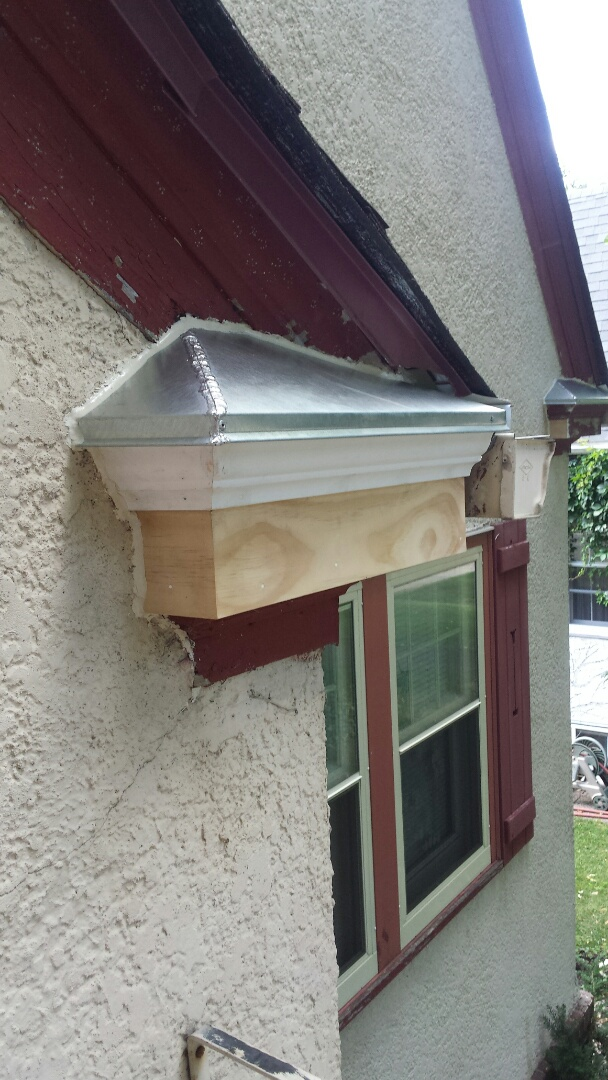 Minneapolis, MN - Replace rotted fascia and crown, fabricated and installed solder seemed metal roof on 9 return ends.