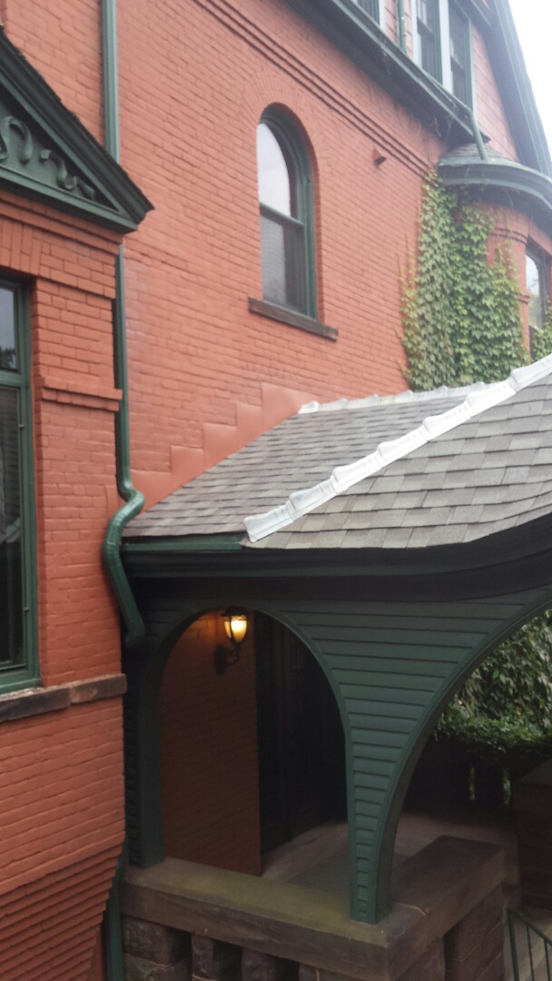 Saint Paul, MN - Repairing leaks by Tuckpointing, reflashing, reshingling and installing new downspout.