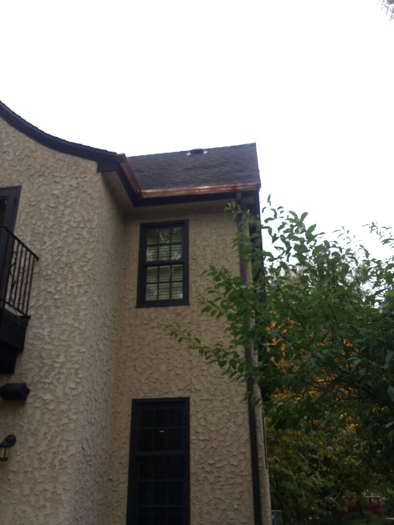 Minneapolis, MN - Remove copper gutters and repaired roof from tree damage. Fabricated and installed new copper gutters