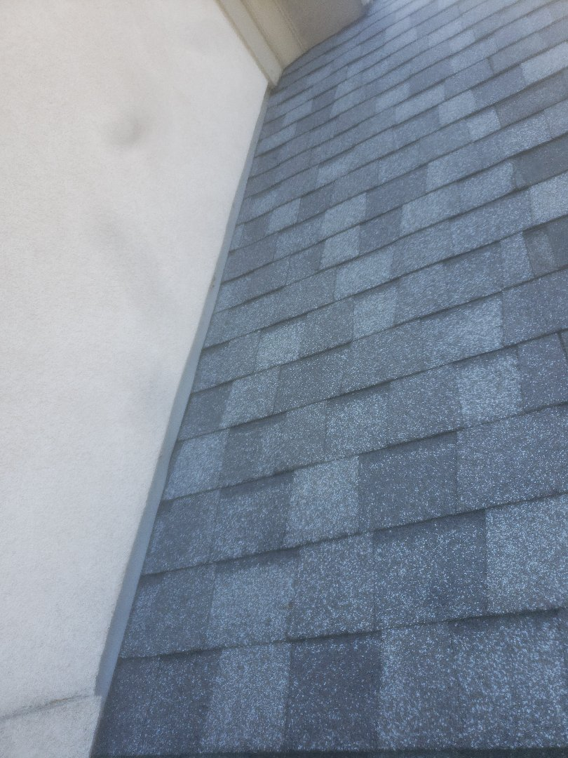 Beavercreek, OH - Tore out old shingles and step flashing and installed new shingles and step flashing