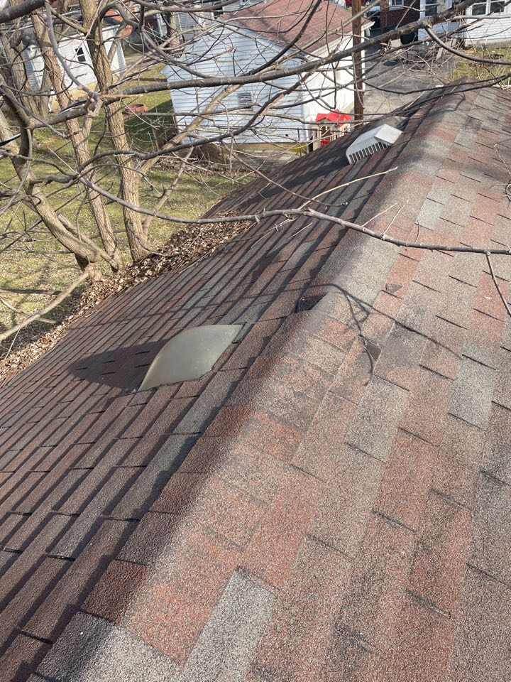 Kettering, OH - Wind damaged shingle roof repair and Velux Sun Tunnel installation in Kettering, Ohio.