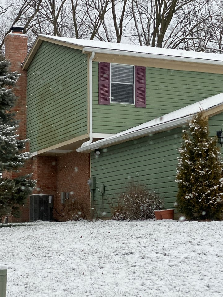 Springboro, OH - Final inspection of the installation of a 5-inch seamless gutter system in Springboro, Ohio.