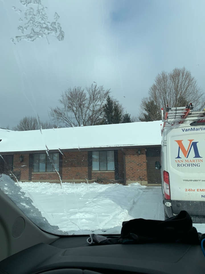Centerville, OH - Installing emergency tarp for a shingle roof leak in Centerville, Ohio.