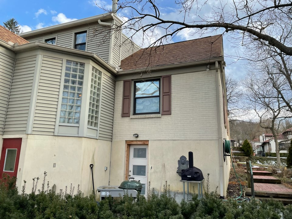 Dayton, OH - Signing contract with customer to replace leaking flat roof and replace gutters. Dayton,OH.