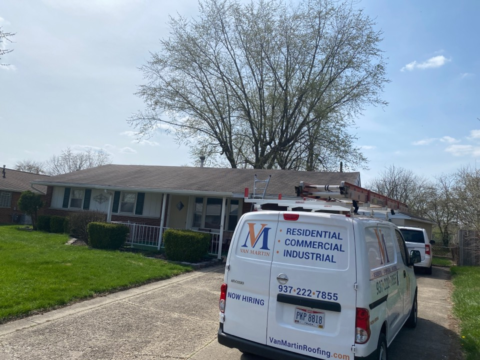 Vandalia, OH - Meeting with a customer to provide a free roof inspection in Vandalia, Ohio.