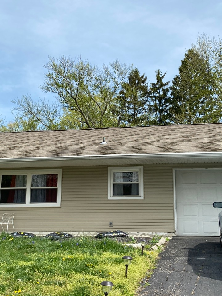 Centerville, OH - Inspecting completed shingle roof repairs in Centerville, Ohio.
