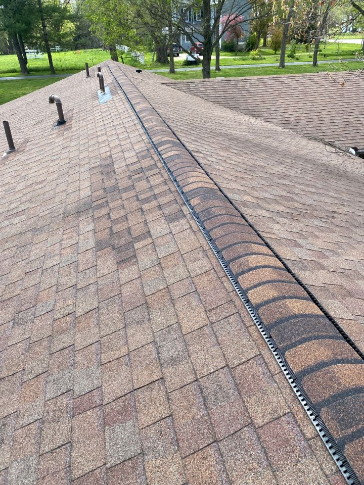 Bellbrook, OH - Cut in and install Omni roll ridge vent in Bellbrook, Ohio.