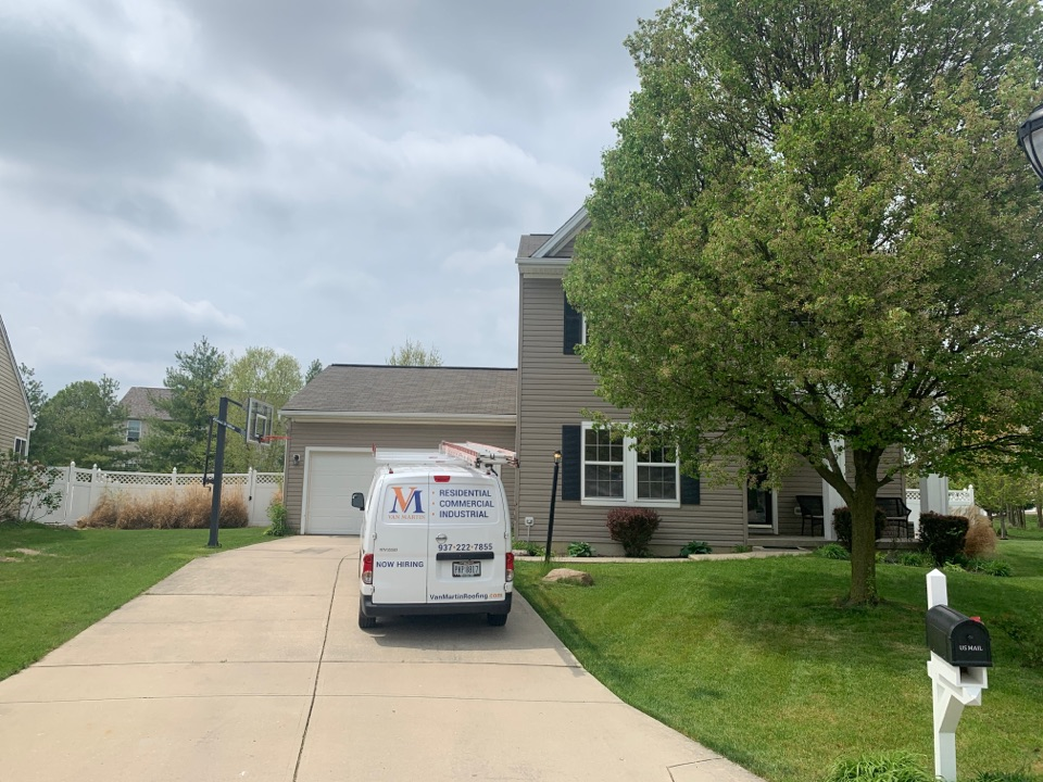 Tipp City, OH - Roof inspection of wind-damaged shingles on a roof in Tipp City, Ohio.