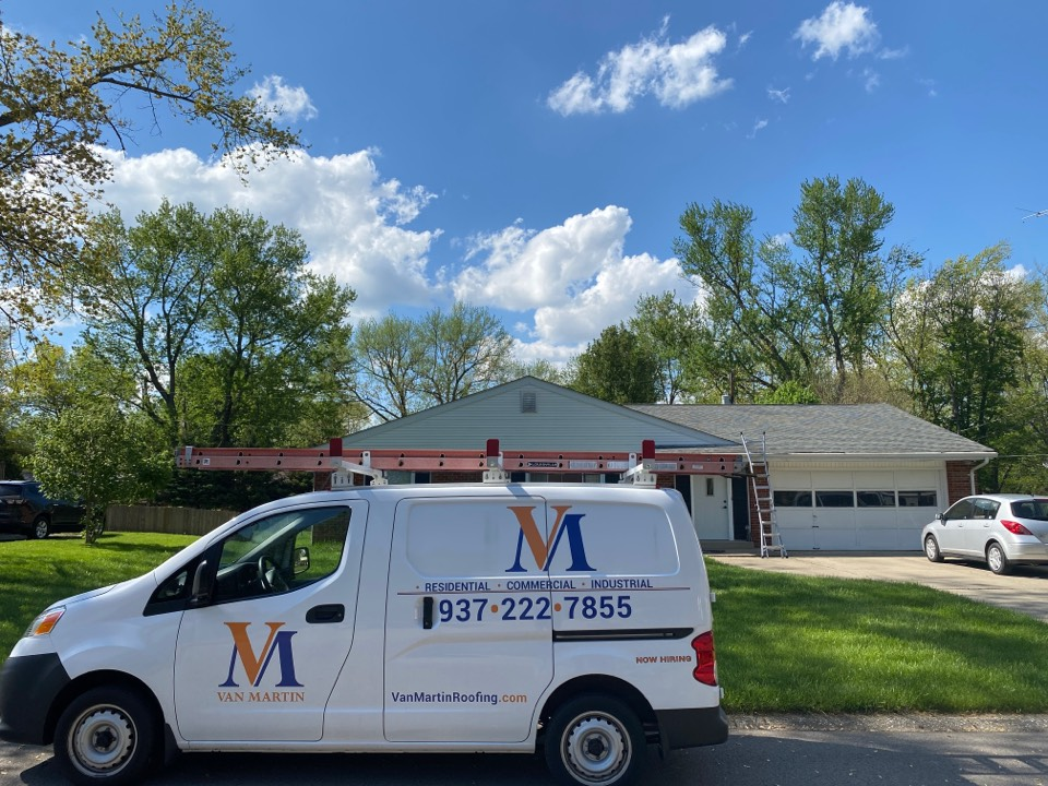 Bellbrook, OH - Meeting with a customer to provide an estimate for a shingle roof repair in Bellbrook, Ohio.