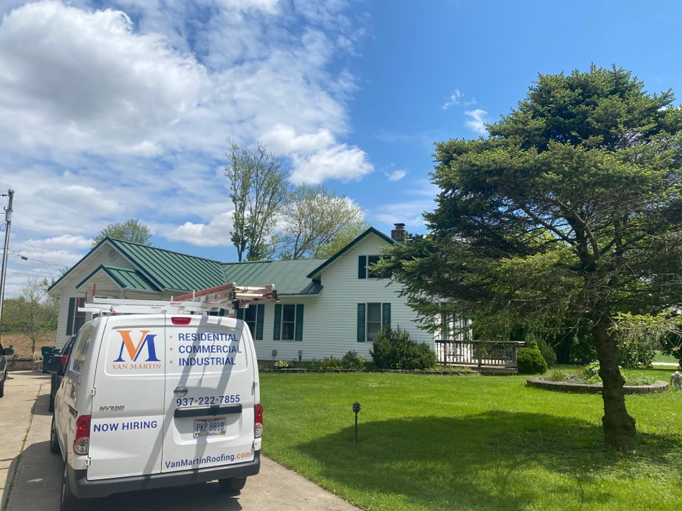 Xenia, OH - Meeting with a customer for a metal roof replacement in Xenia, Ohio.
