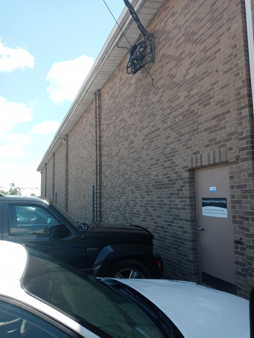 Providing an estimate for a commercial roof replacement in Sugarcreek Township, Ohio.