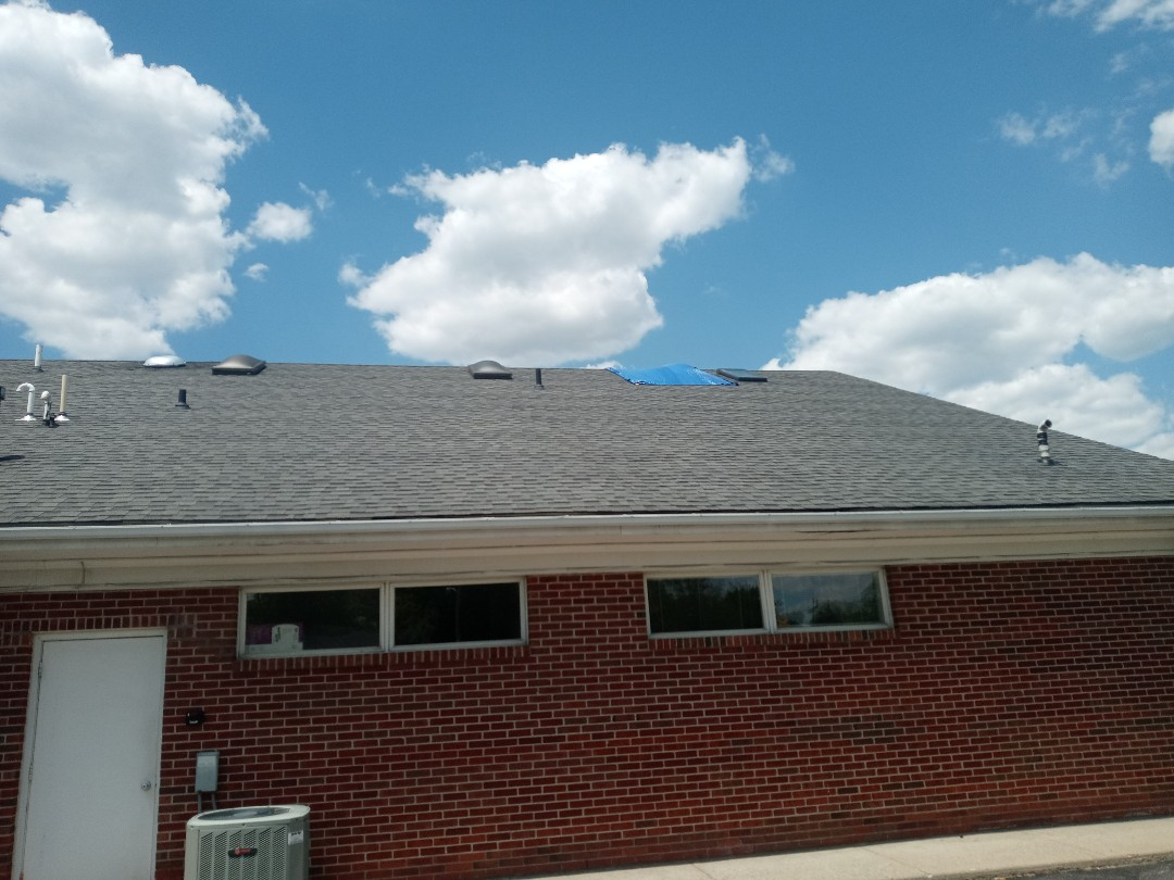 Lebanon, OH - Emergency tarp for a commercial shingle roof leak in Lebanon, Ohio.