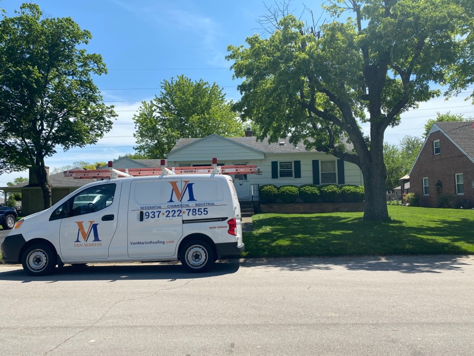 Englewood, OH - Meeting with a customer for a shingle roof repair in Englewood, Ohio.