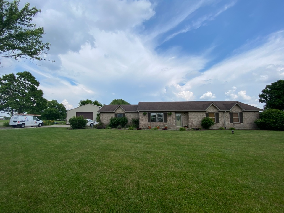 Brookville, OH - Meeting with a customer for a roof replacement in Brookville, Ohio.