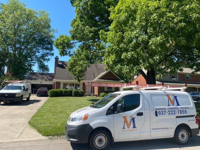 Kettering, OH - Meeting with a customer for free roof inspection in Kettering, Ohio.
