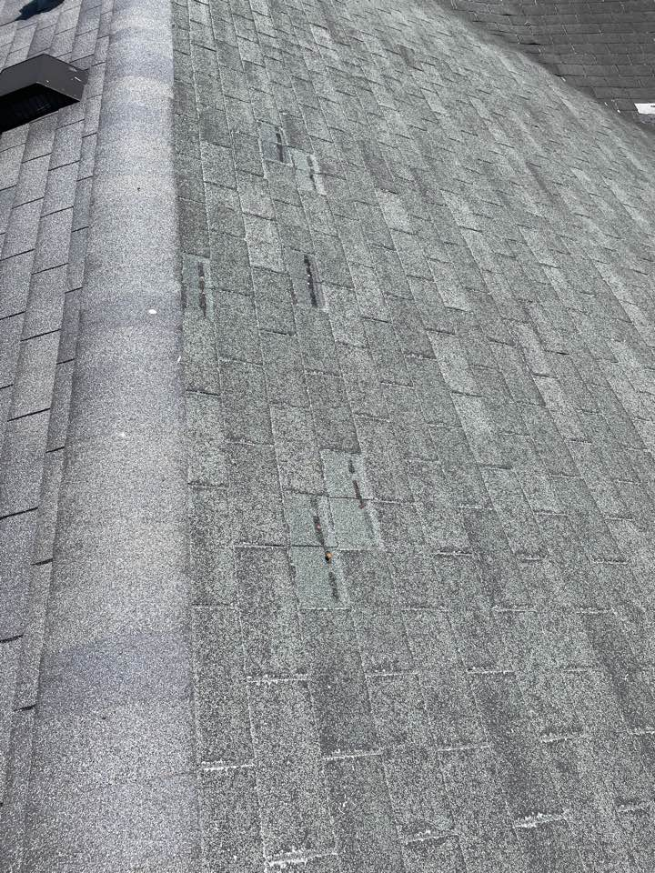 Enon, OH - Providing an estimate for an insurance claim to replace a wind-damaged shingle roof in Enon, Ohio, and install new CertainTeed shingles.