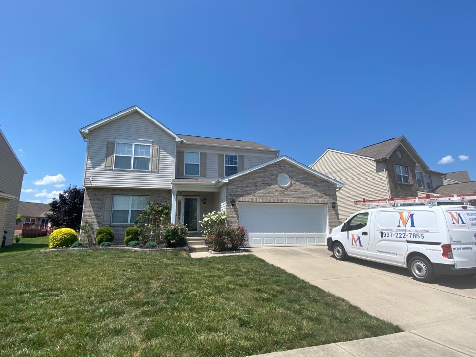 Dayton, OH - Meeting with a customer to provide an estimate for a shingle roof repair in Dayton, Ohio.