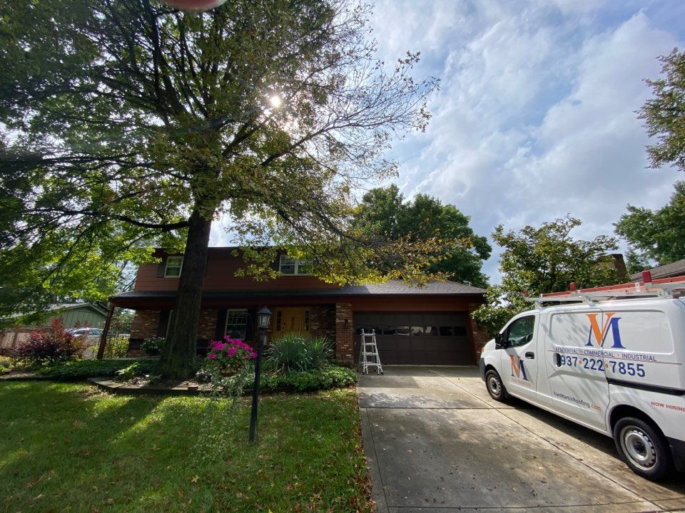 Dayton, OH - Meeting with a customer for a roof repair in Kettering, Ohio.