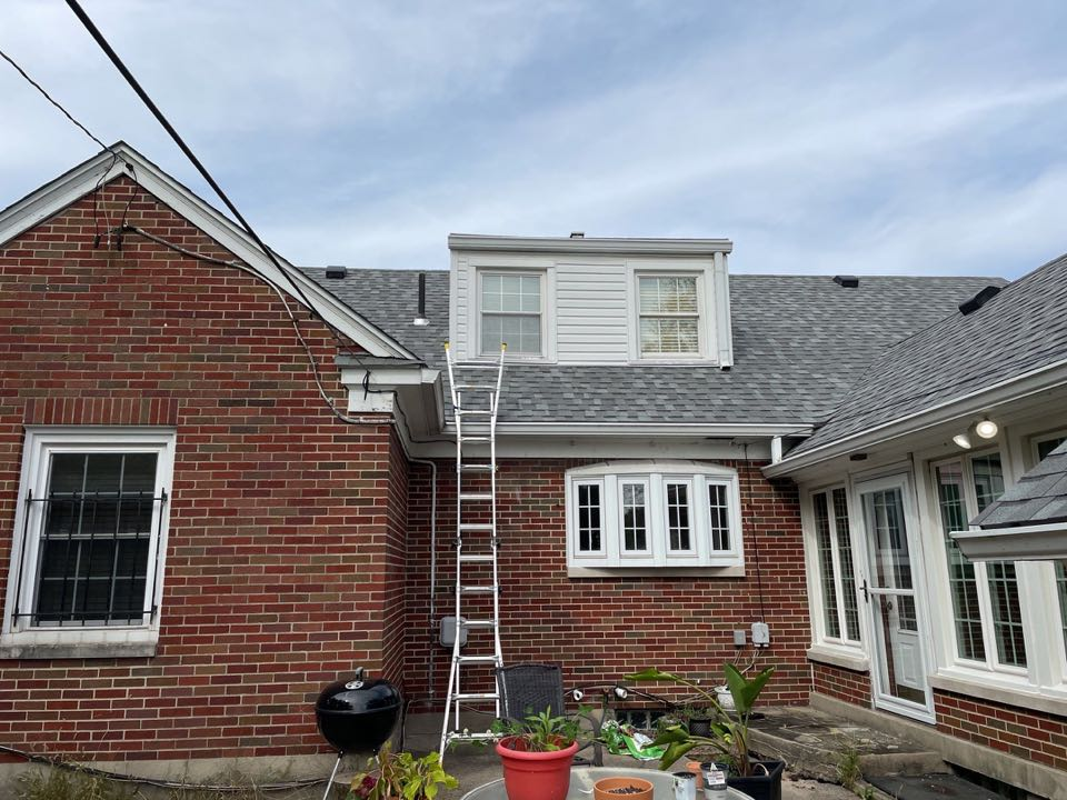 Free estimate to replace a flat roof on a leaking dormer in Dayton, Ohio.