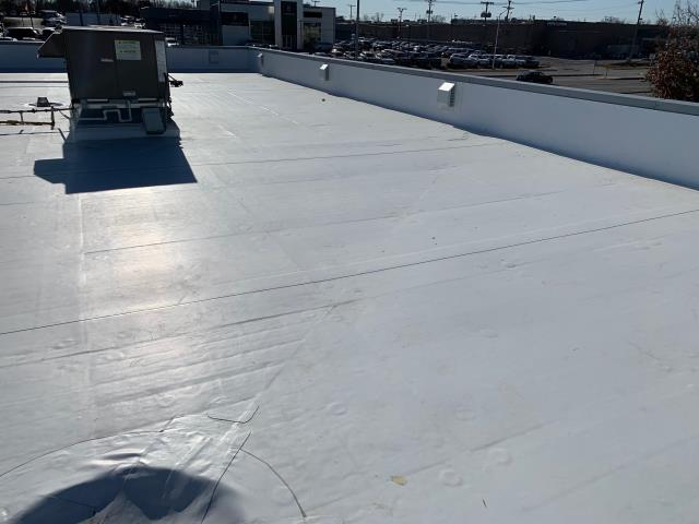 Olathe, KS - Tear off multiple layers and install a new TPO roof system