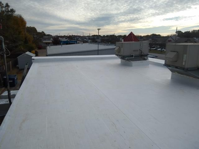 Lawrence, KS - Tear off multiple layers and install a TPO roof system