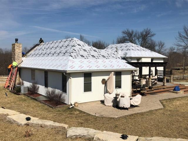 Edgerton, MO - Roof replacement. Installing a standing seam metal roof.