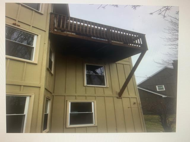 Lee's Summit, MO - Removing deck and sliding door and installing a window. Installing James Hardie Siding on entire home.