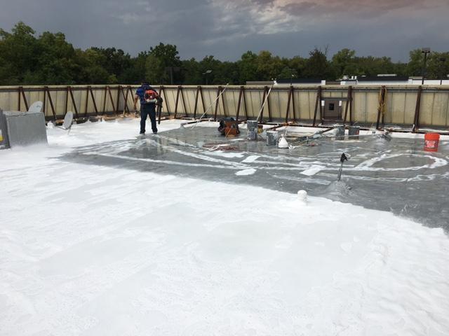 Kansas City, MO - Finishing up the top coat off Silicone roof coating