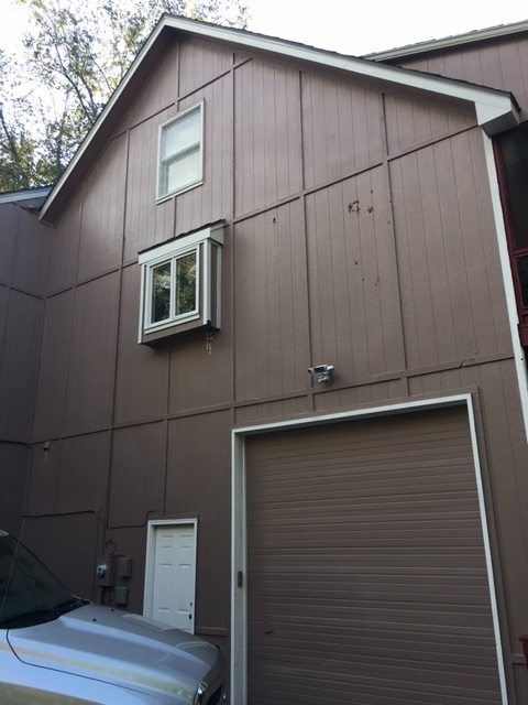 Kansas City, MO - Wood Pecker problem. Solution = James Hardie Siding