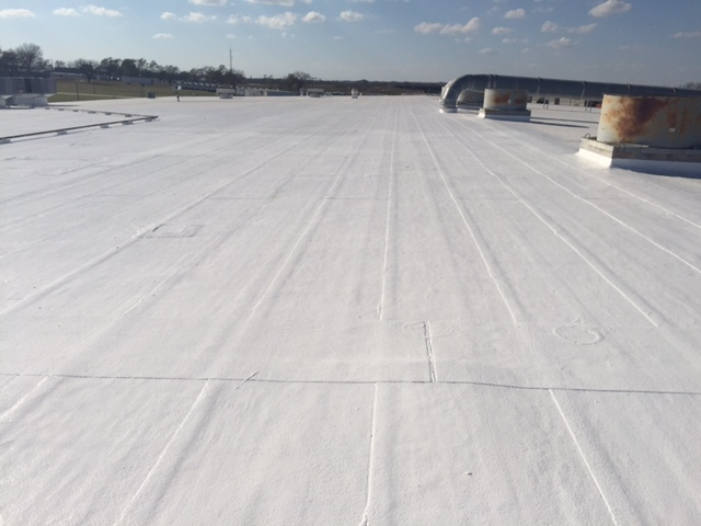 Ottawa, KS - Roof coating over a modified bitumen.