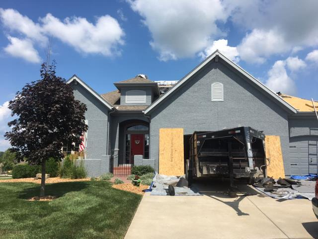 Kansas City, KS - Finishing up on a roof replacement