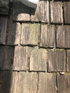 Leawood, KS - Installing a new roof. Replacing a worn out wood shake roof.