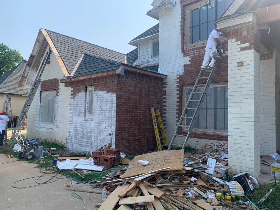 Tulsa, OK - Painting the house.
