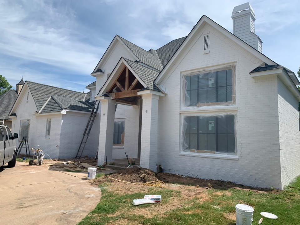 Tulsa, OK - Getting the final coat of paint on the exterior on this custom remodel