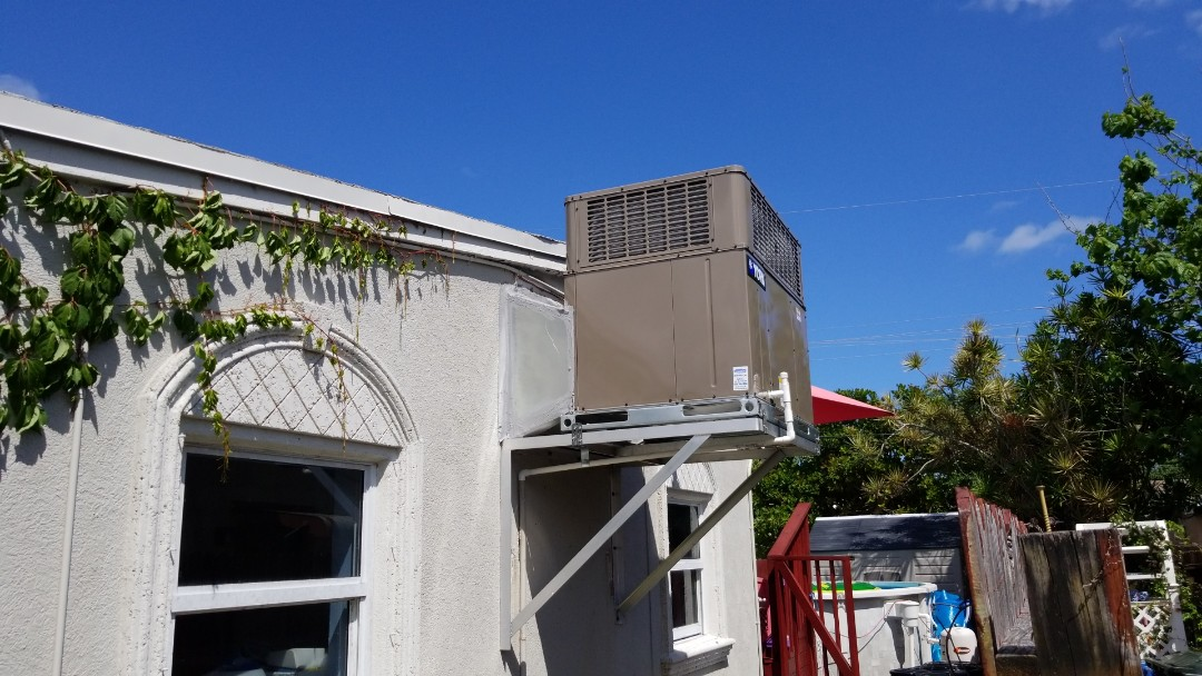 Fort Lauderdale, FL - During this call, we replaced a gable mounted air conditioning unit, this particular unit uses a thermostat and humidistat control to help prevent heat and moisture buildup inside the attic. The unit was installed with a new engineered aluminum support bracket giving our customers the best equipment with quality installation