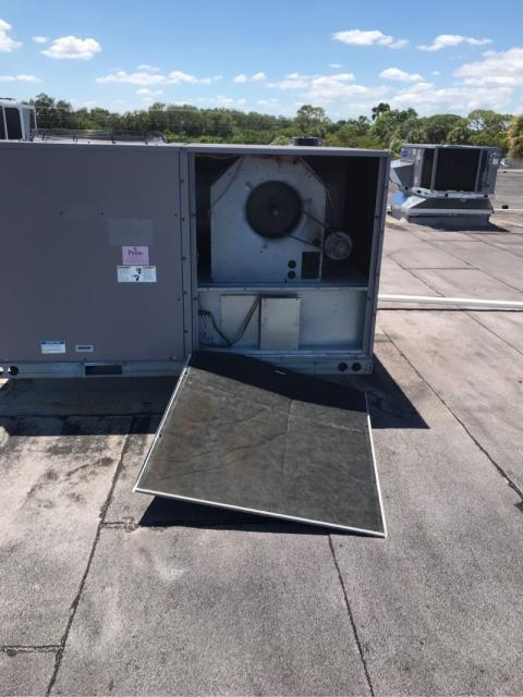 West Palm Beach, FL - During this commercial customer's service call, we completed the repairs which included replacing a condenser fan  motor and blade. Attached is the system before we corrected the problem.