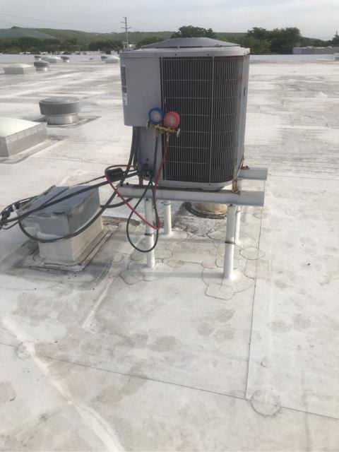 During this commercial ac repair we found that the system was not cooling. Our technician reviewed the entire system, and found the following issues: That the system is leaking and the condenser fan motor rusted out. Due to the age of the system, we recommend replacement over repair.