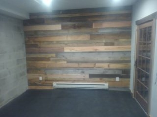 Chatham Township, NJ - Exercise room in basement reclaimed wood on walls