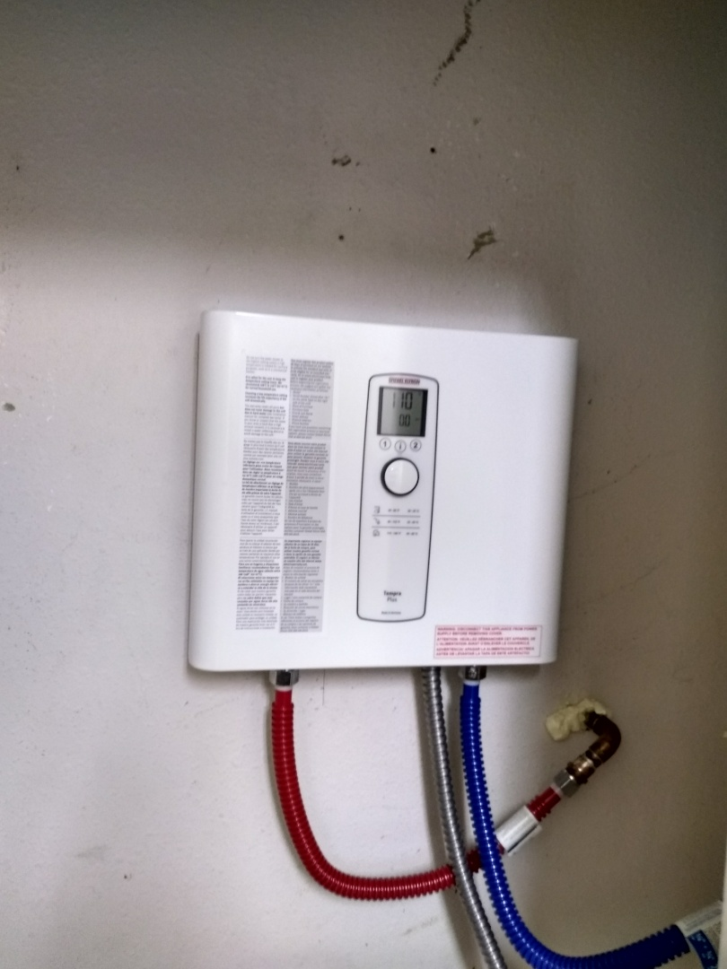 Remove tank electric water heater and install electric tankless water heater with emergency shutoff box and proper new electrical wiring in conduit
