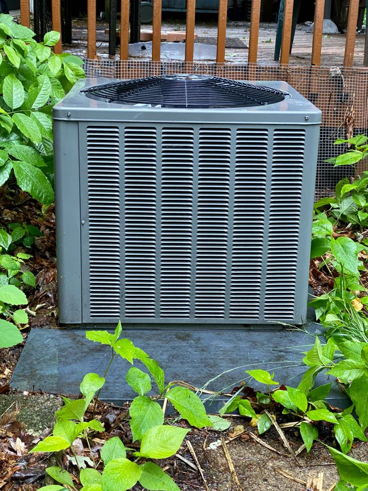 Air conditioning clean and check on a Rheem unit.