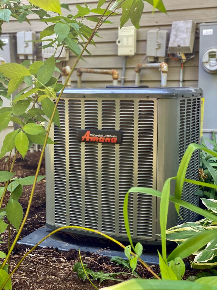 Air conditioning clean and check on an Amana unit.
