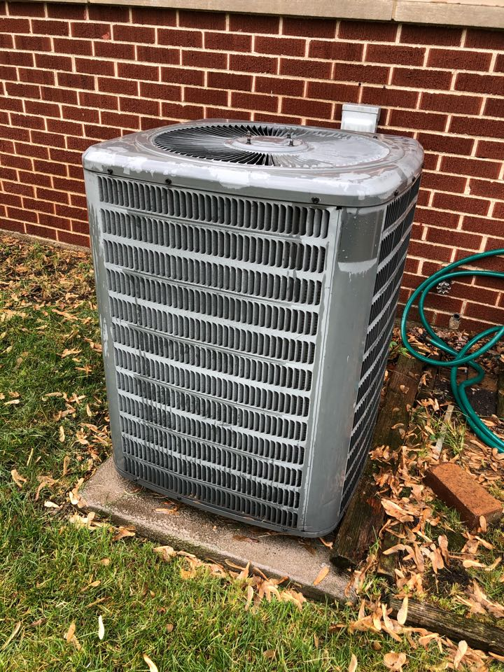 Elk Grove Village, IL - Performing an annual air conditioning tune up, on a Goodman AC system, in ElkGrove Village, IL 60007