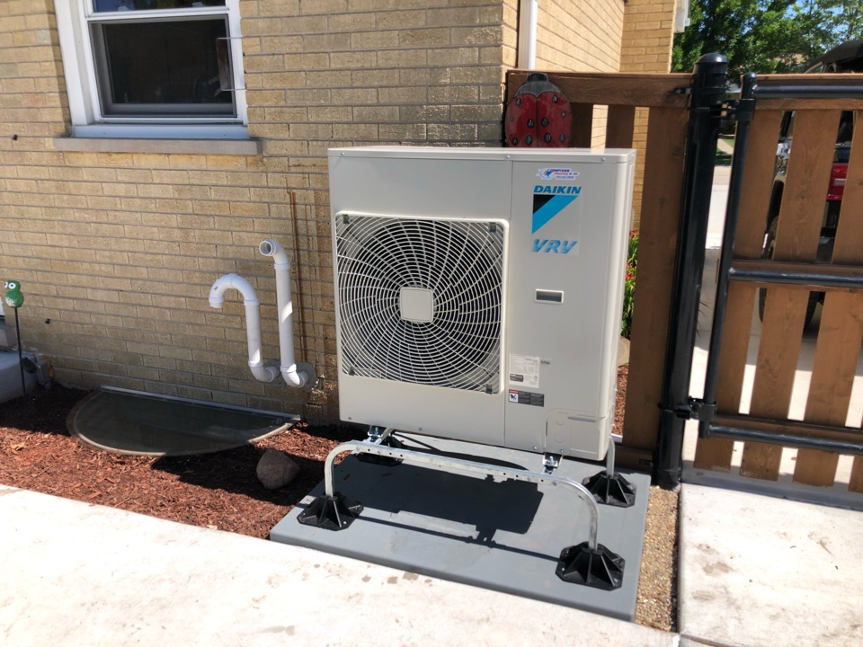 Schaumburg, IL - Doing a post- installation follow up visit with customer after replacing their Carrier furnace and AC with a Daikin VRV Life heat pump and modular gas furnace.