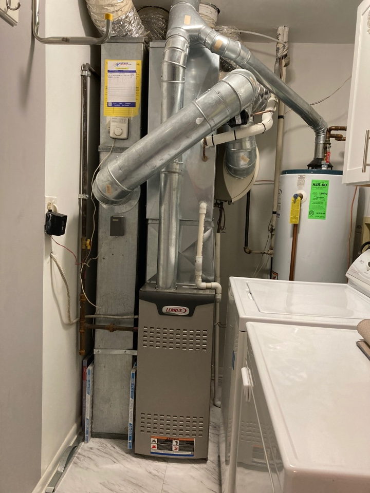 Clean and check on a Lennox furnace.