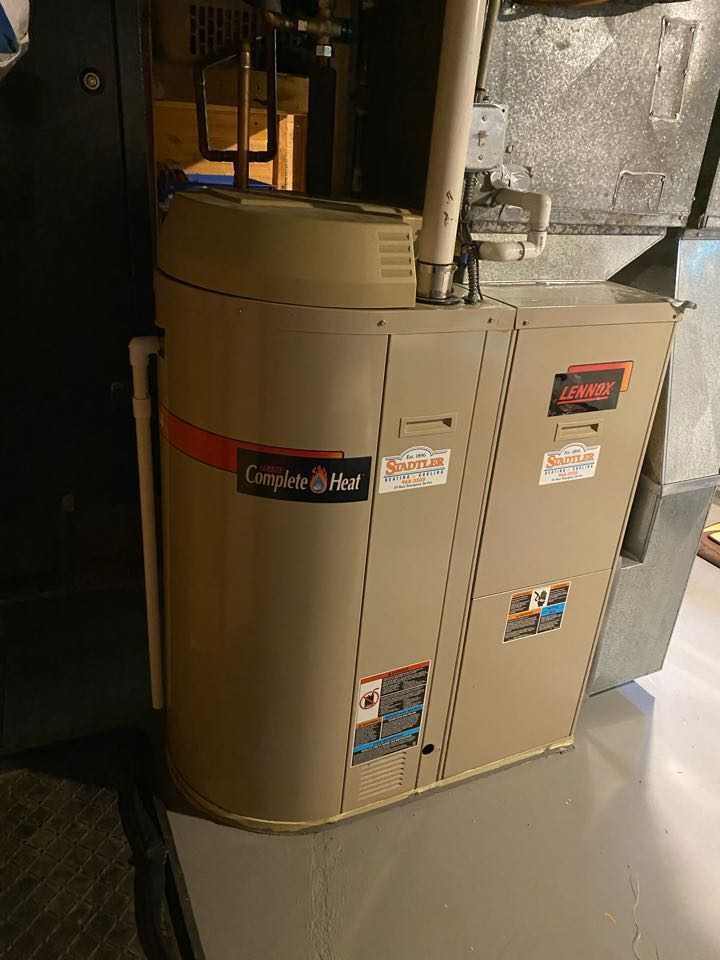 """Downers Grove, IL - Providing an estimate for replacing a Lennox """"Complete Heat"""" furnace/ water heater combination with a Daikin VRV Life heat pump and a heat pump water heater, as part of the home electrification project."""