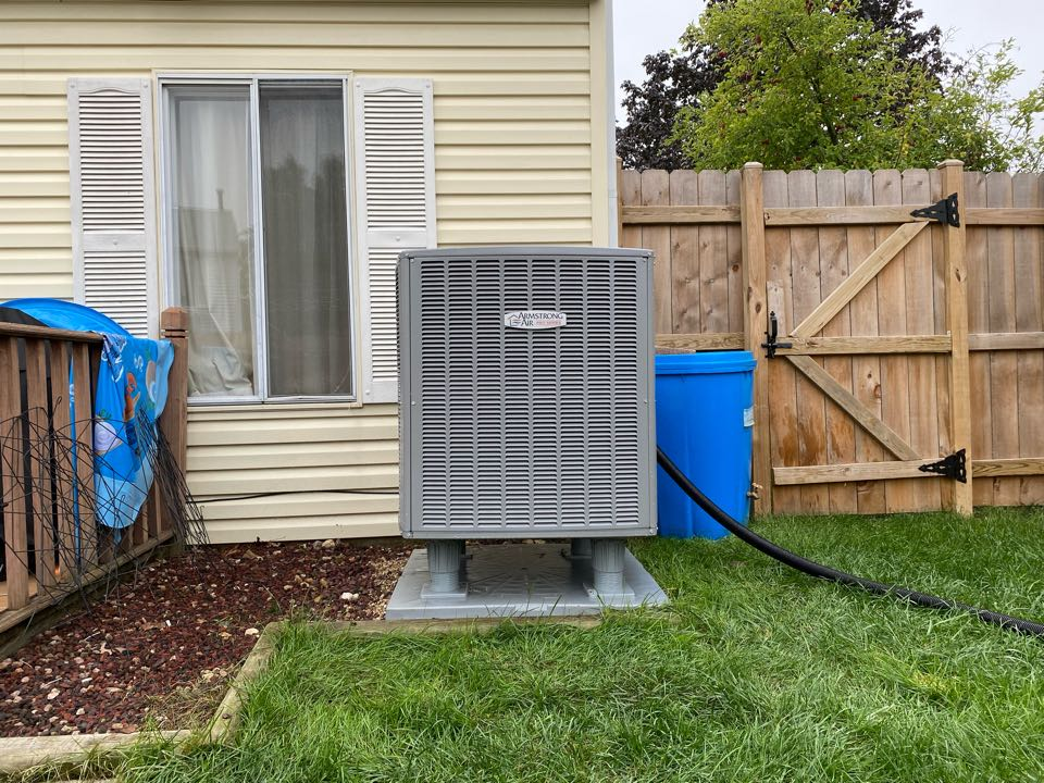 Performing annual maintenance on an Armstrong furnace and heat pump, in Streamwood, IL 60107.