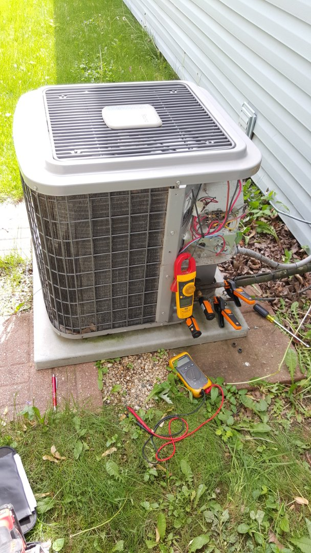 West Dundee, IL - Performing a Clean and Check on a Heil AC unit in Streamwood, IL.