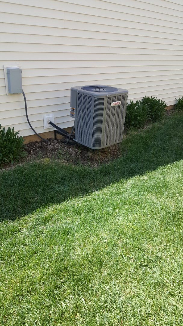 Elk Grove Village, IL - Finishing maintenance on a standard Lennox AC unit for a family in Elgin, IL