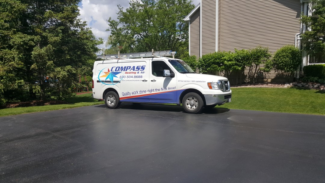 Sleepy Hollow, IL - Finishing a AC clean and check on a 28 year old Bryant condenser for a Compass Heating and Air loyalty customer in Sleepy Hollow, IL